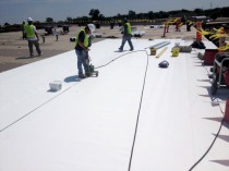 Installation of a reflective white thermoplastic polyolefin roof.